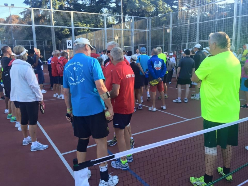 60-mens-doubles-getting-ready-to-play
